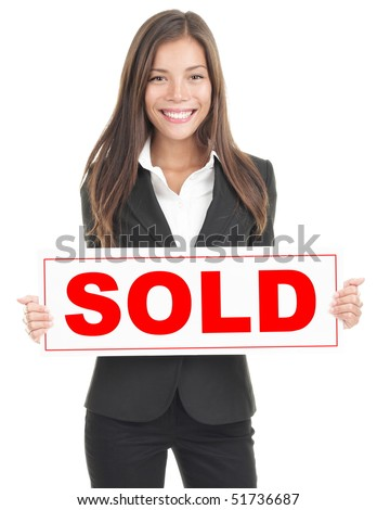 Real estate agent showing sold sign. Isolated on white background. Mixed asian / caucasian woman.