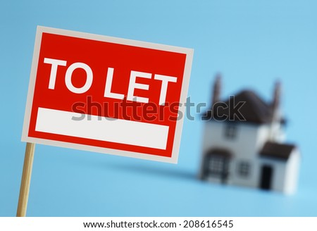 Real estate agent to let sign with house in background - stock photo