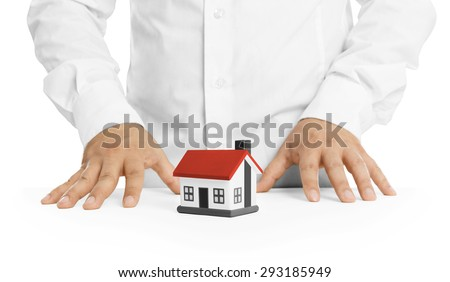 Real estate agent with house model -Concept of deal and real estate - stock photo