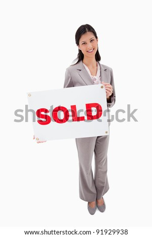 Real estate agent with sold sign against a white background