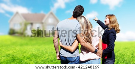Real Estate agent woman with clients near new house. - stock photo