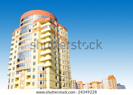 real estate. big building on blue sky - stock photo