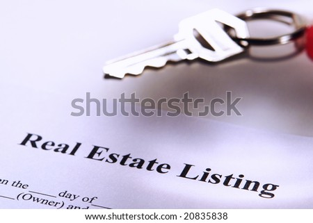 Real estate broker agent listing contract and key on a keychain (fictitious document with authentic legal language)  - stock photo