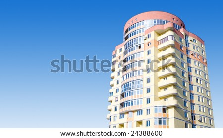 real estate. building on the blue sky - stock photo