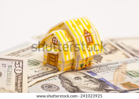 Real estate business concept. Dollar banknote with House - stock photo