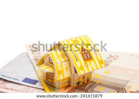 Real estate business concept. Model of toy house placed on Euro banknotes  - stock photo