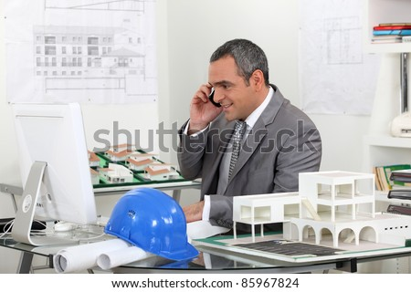 real estate businessman working in his office - stock photo