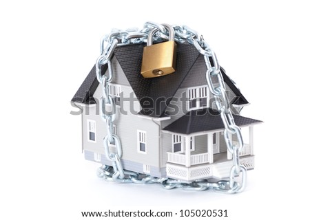 Real estate concept - chain with lock around the home architectural model, isolated - stock photo