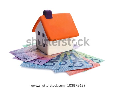 Real estate concept - house and money on white background - stock photo