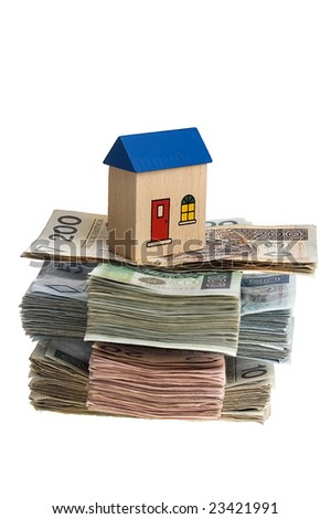 Real estate concept - House on stack of polish zlotys isolated - stock photo