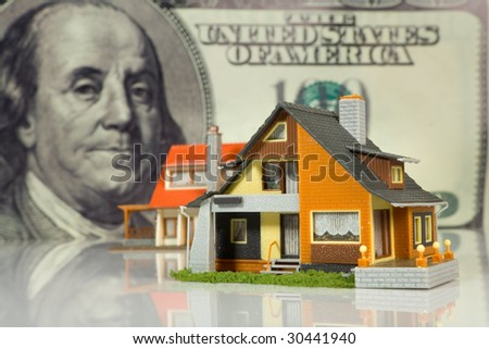 Real Estate concept on big dollar background - stock photo