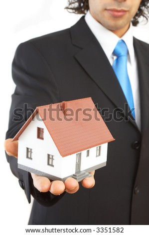 real estate concept with a mini house - stock photo