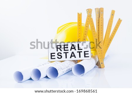 real estate concept with construction tools and projects - stock photo