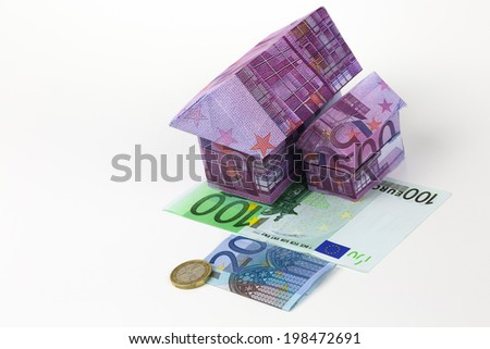 Real estate concept with Euro bank notes House and coins - stock photo