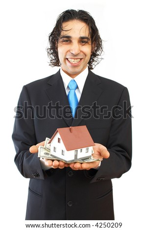 real estate concept with money and mini house - stock photo