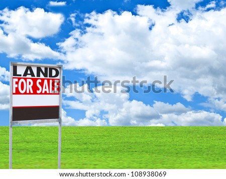 """Real estate conceptual image - """"FOR SALE"""" sign on empty meadow - stock photo"""