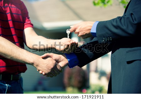 Real Estate: Congratulations and Here's Your Home Keys - stock photo