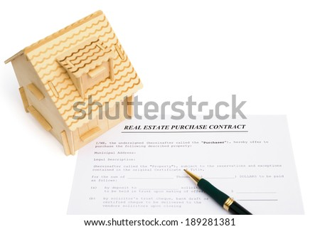 real estate contact and an architectural model with clipping path - stock photo