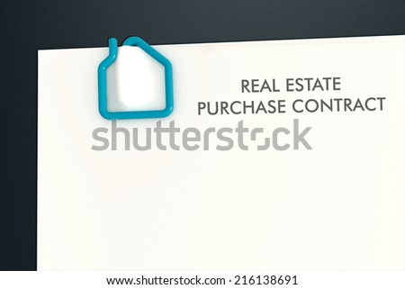 Real estate contract document template with turquoise paper clip on dark laminate desk - illustration clipping path - stock photo