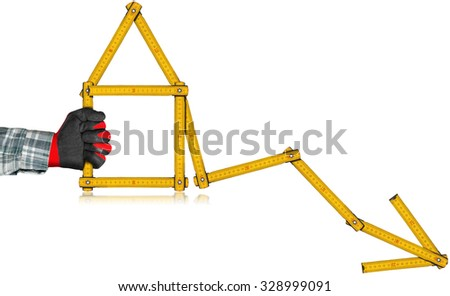 Real Estate - Decreasing Sale Graph / Hand with work glove holding a wooden yellow meter in the shape of house and diagram of decrease. Isolated on white background - stock photo