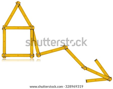 Real Estate - Decreasing Sale Graph / Wooden yellow meter in the shape of house and diagram of decrease. Isolated on white background. - stock photo