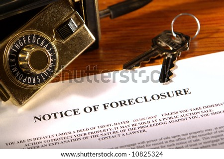 Real estate financial lender home foreclosure notice with set of house keys and open Realtor lock box (fictitious document with authentic legal language) - stock photo