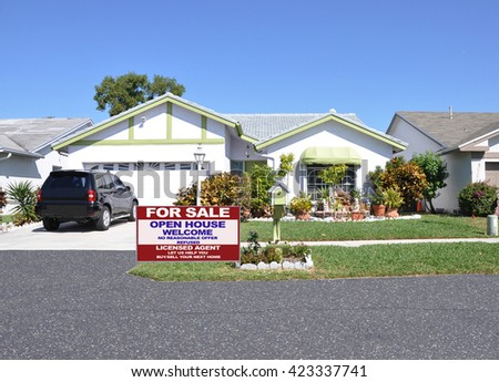 Real estate for sale open house (another success let us help you buy sell your  next home)  welcome sign Beautiful Suburban Ranch Home Residential Neighborhood Clear Blue Sky Sunny USA - stock photo