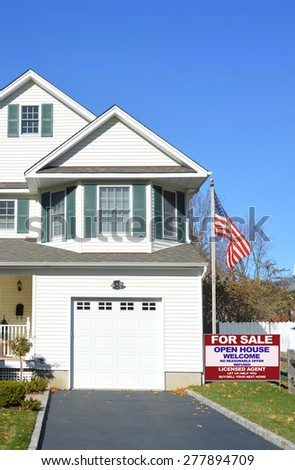 Real estate for sale open house welcome sign American flag pole Suburban Home Garage Windows residential neighborhood USA Clear Blue sky - stock photo