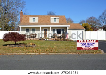 Real estate for sale open house welcome sign Beautiful Cape Cod style home autumn day clear blue sky residential neighborhood USA