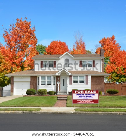 Real estate for sale open house welcome sign Beautiful Suburban Home residential neighborhood Autumn Season Day Blue Sky - stock photo