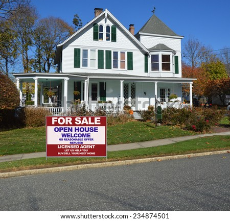 Real Estate for sale open house welcome sign curb of suburban gable front Victorian style home in residential neighborhood clear blue sky USA - stock photo