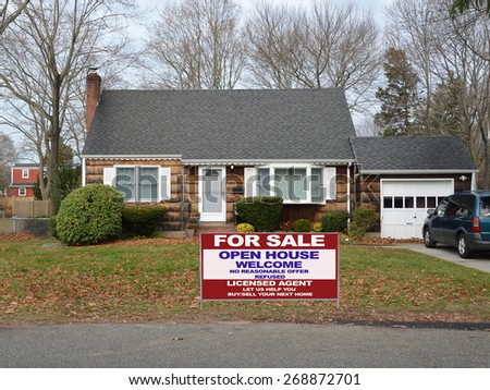 Real estate for sale open house welcome sign Suburban Brown Wood Shingle Cape Cod style home Autumn day residential neighborhood USA - stock photo