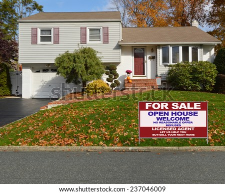 Real Estate for sale open house welcome sign Suburban high ranch house autumn day residential neighborhood USA