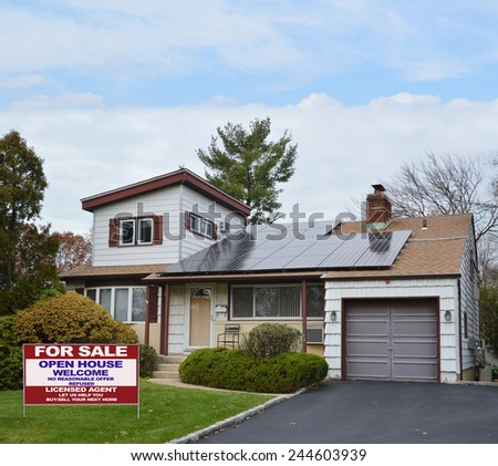 Real Estate for sale open house welcome sign Suburban Ranch style home with solar panel on roof residential neighborhood USA blue sky clouds