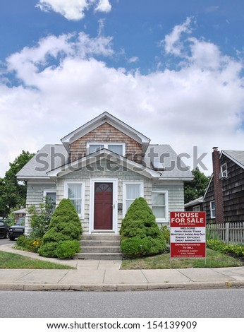 Real Estate for Sale Sign House For Sale Energy Efficient Great Amenities in Residential Suburban Home Neighborhood USA Blue Sky Clouds - stock photo