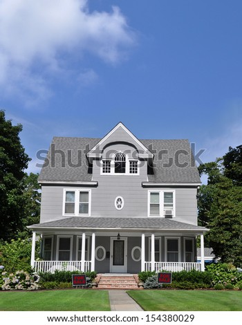 Real Estate For Sale Sign Large Gray Suburban  Manicured Front yard Lawn Sunny Blue Sky Cloud Residential neighborhood USA - stock photo
