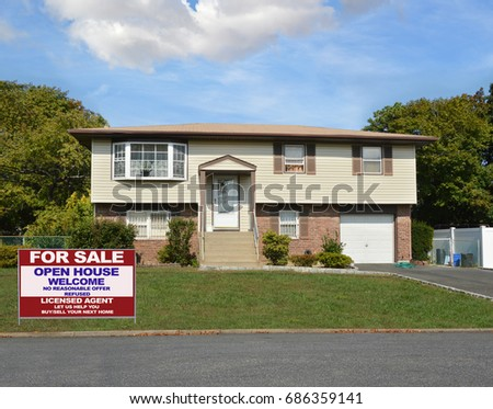 Real Estate For sale sign Suburban High Ranch Home Blue sky clouds USA