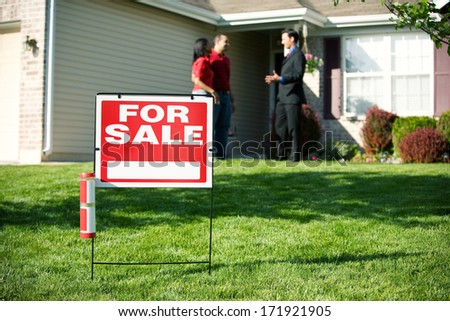 Real Estate: For Sale Sign With Agent And Home Buyer Behind - stock photo