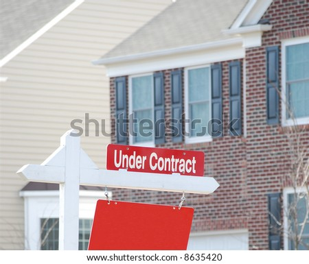 real estate for sale with under contract sign in red - stock photo
