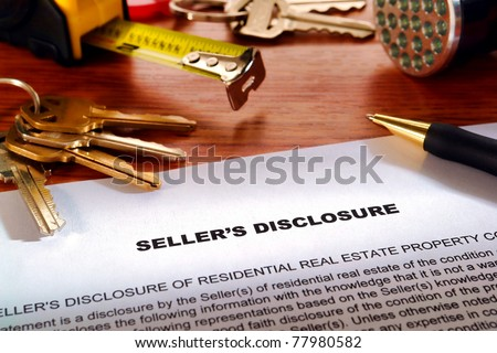Real estate homeowner seller property disclosure condition statement with house keys and inspection flashlight on a home owner desk (fictitious but authentic language document) - stock photo