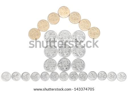 Real estate house built with Australian coins and isolated on white - stock photo