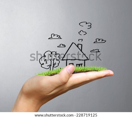 Real estate idea, holding house - stock photo