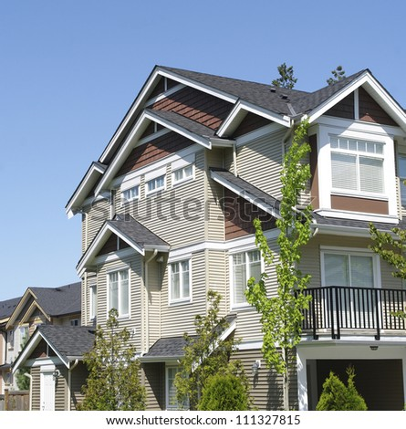 real estate investment property in condominium. homes. financial concept of retirement savings by earning money from ownership and rental housing . exterior of house with blue sky background