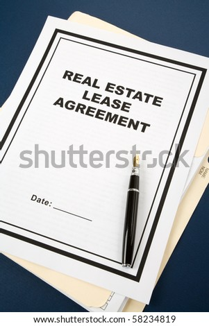 Real Estate Lease Contract and pen close up - stock photo