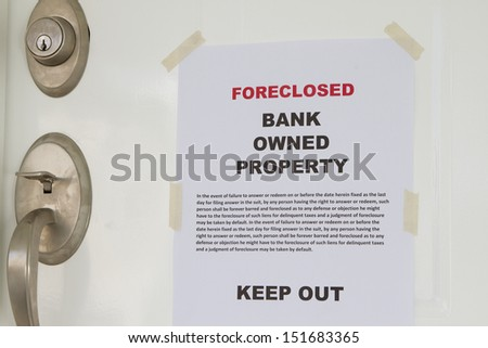 Real estate lender bank owned keep out sign notice - stock photo