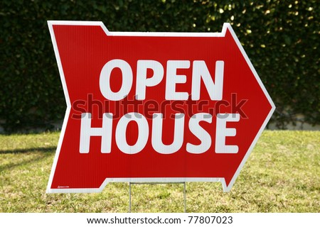 Real Estate Open House sign in a yard outside - stock photo
