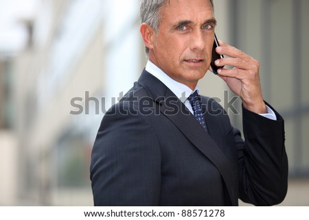 Real estate promoter on phone - stock photo