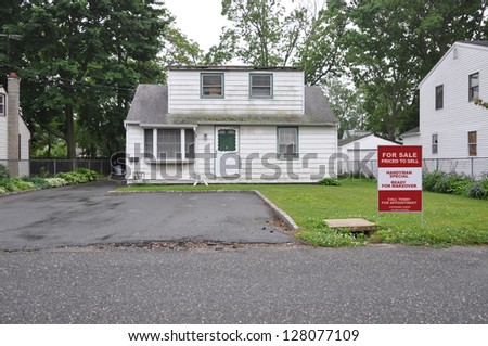 Real Estate Realtor For Sale Sign Handyman Special Bungalow Home in bad condition with Dormer Extension - stock photo