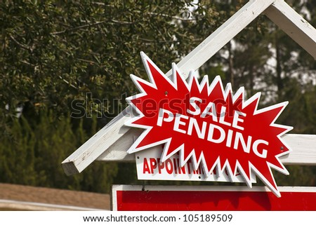 Real estate sign has a sale pending notice. - stock photo