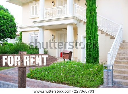 Real estate sign in front of new house for rent - stock photo